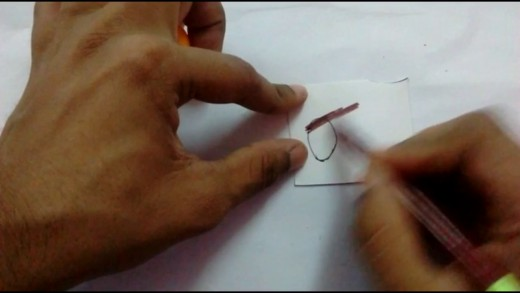 Draw a petal shaped structure for the wing of the owl on the paper.
