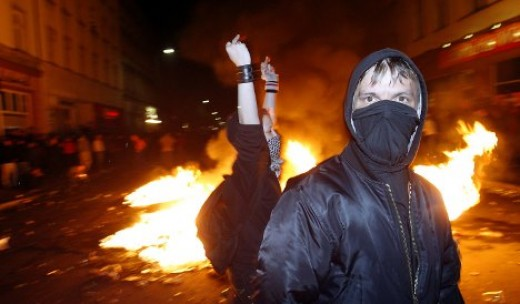 Various ANTIFA rioting in the streets, causing fires.