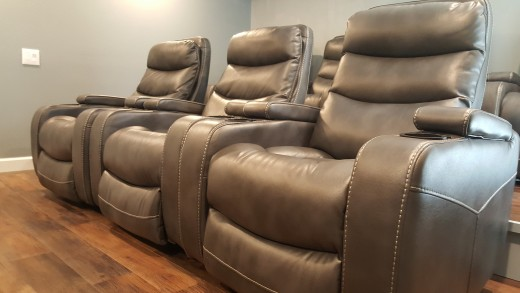 The seating we chose are 10 leather power recliners laid out in 3 rows