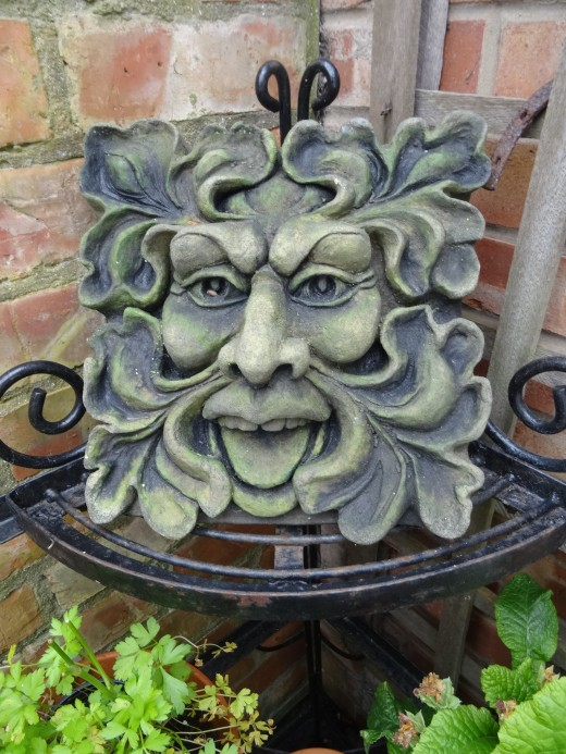 The Green Man, cast in concrete and available for purchase.