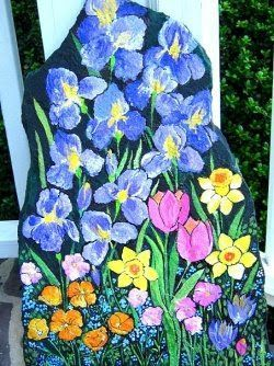 Hand-Painted Irises, Tulips, Daffodils, and Crocus on a Garden Rock by nancymaggielee