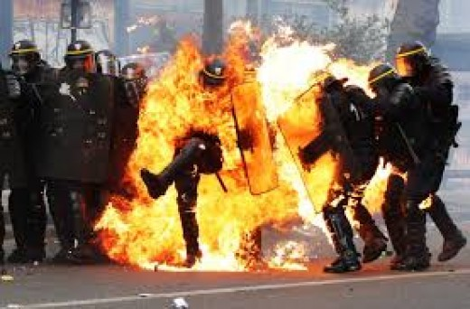 French police, set on fire by violent protestors.