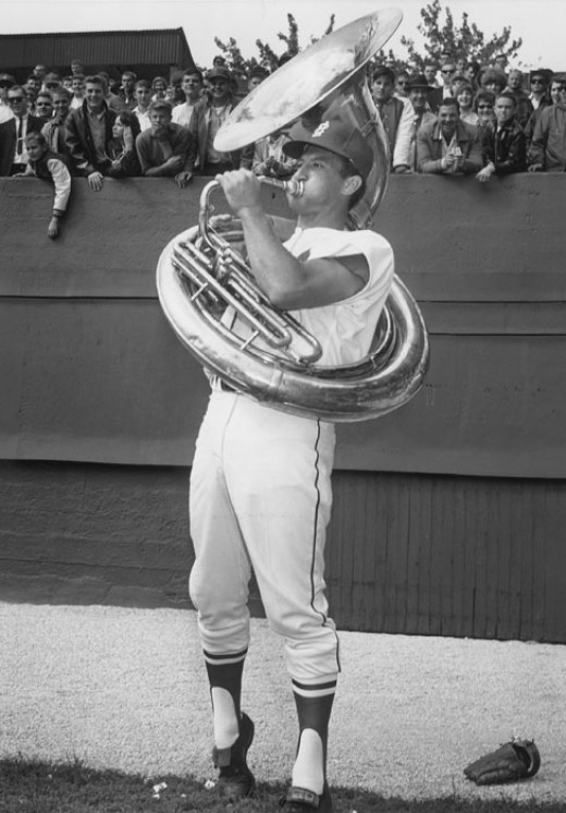 Bob Uecker playing a sousaphone in the outfield before Game 1 of the 1964 World Series.