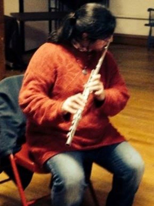 Seafarer Mama playing flute at an open mic