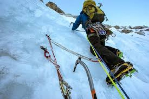The ultimate in mountain climbing is climbing a snow covered mountain peak.