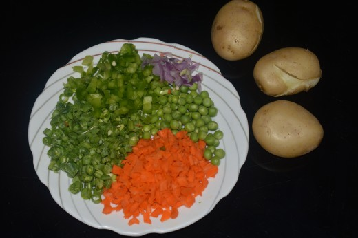 Step one: boil the potatoes and keep ready chopped vegetables