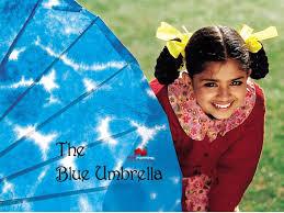 Binya with her Blue Umbrella