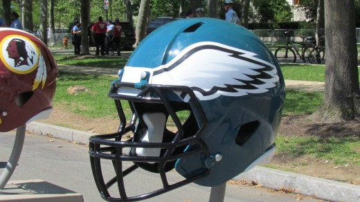 A large helmet of the Philadelphia Eagles, along with numerous other helmets for other teams in the NFL.