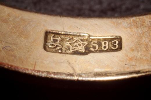 Gold hallmark from the Soviet Union.