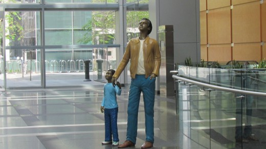 A statue that is featured in the Comcast Center of a father and son, located downtown Philadelphia at 1701 John F. Kennedy Blvd.