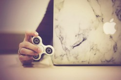 Fidget Spinner the Story, Tricks, and Responses