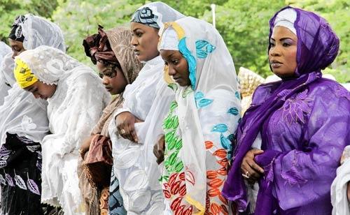 Muslim Women worshiping Allah through prayer.