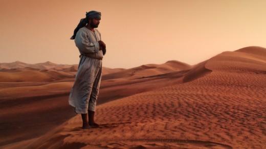 Desert  Bedouin Muslim Praying in the evening to Allah.