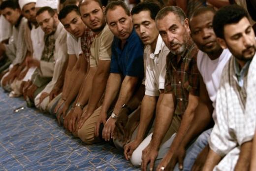 Muslims in Spain worshiping through prayer to Allah.