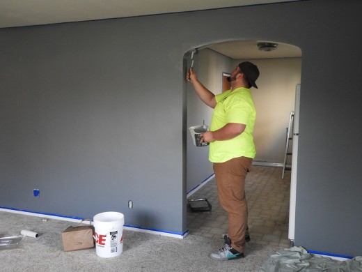 Renovating a house by painting.