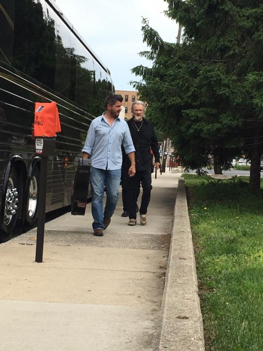 Maxi took this photo of Kris Kristofferson and his manager, Michael, who is carrying his guitar.
