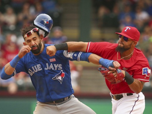 Joey Bautista and Rougned Odor exchange fists.