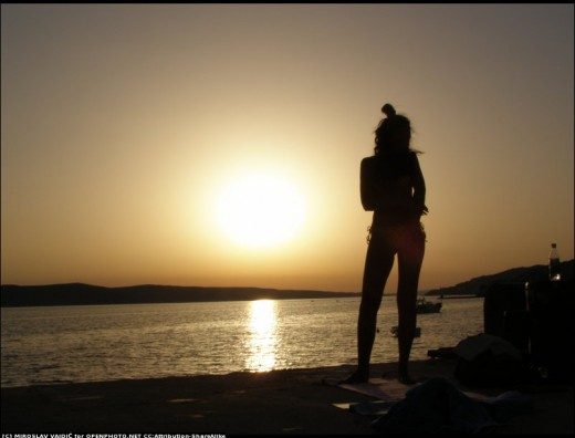 Nice picture of woman, enjoying sunset