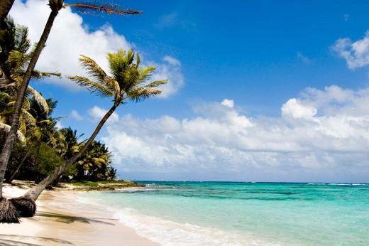 Tiny isle of Marie Galante, soft sandy beaches, balmy warm air, lissom lasses...