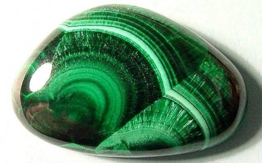 The stone above is malachite and an example of what a vessel might look like.
