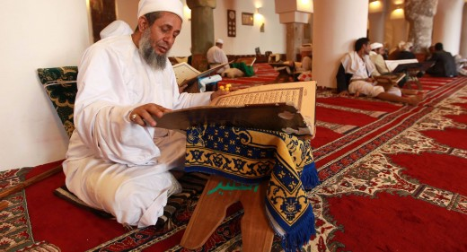Reading Quran in a mosque during Ramadan.