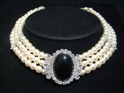 A multi-stringed pearl necklace displayed for easier viewing.