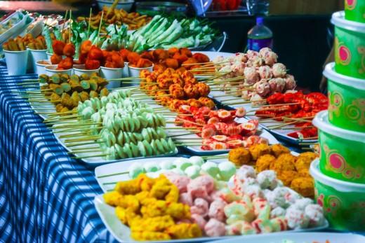 """Mainly Fish balls, """"Kikiam"""" , Kwek-Kwek(fried hard boiled egg covered in flour with orange coloring), etc."""