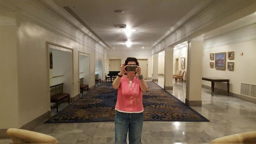 Diane's selfie in a giant mirror on the second floor.