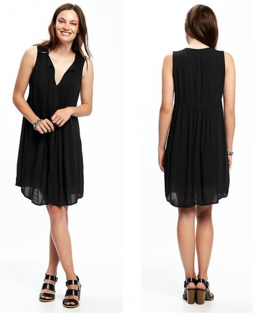 my ideal little black dress for warm weather: sleeveless, pintuck, knee-length -- A-line swing style  -- rounded, split neckline and tassel tie -- soft, medium weight rayon crepe with lining