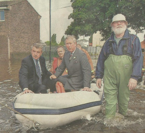 The Man From The Post Office Standing Alongside Prince Charles In A Rubber Dinghy!