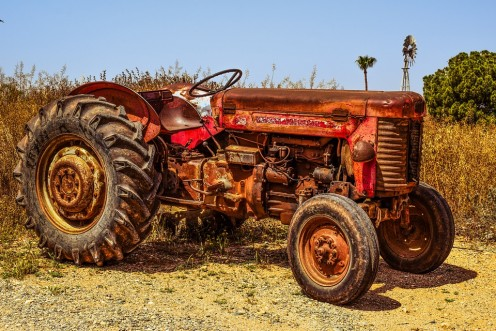 Worn out tractor used by  a busy farmer.