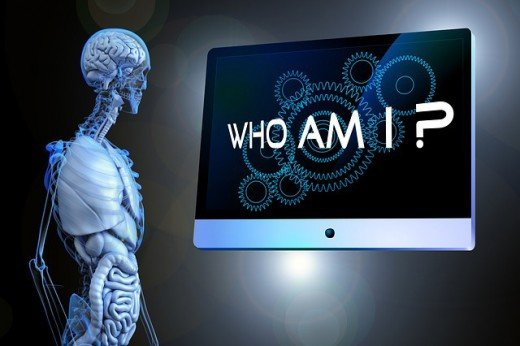 """A skeleton looking at the words """"Who am I?"""" printed on a board."""