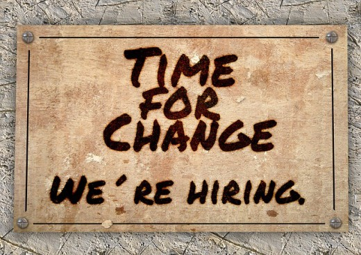 """A sign posted with the words """"Time for Change, We're Hiring."""""""
