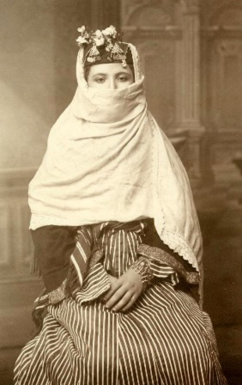 Circa 1867-1885. (A combination hijab and niqab)