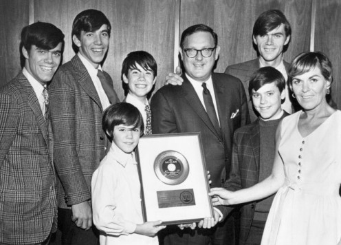 The Cowsills receiving a  gold record for received the song, Rain and Other Things in The Park, in 1967.