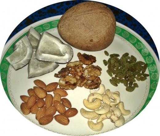 copra, sun dried green raisins, cashews, almonds, and walnuts (pistachios are missing)