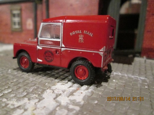 A Royal Mail Land Rover Series II 'hard-top' (van) delivers locally collected mail for collection by the evening pick-up goods)