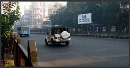 A Police jeep roaring past : viewed from the eastern side of 'Rajbhavan', Calcutta.