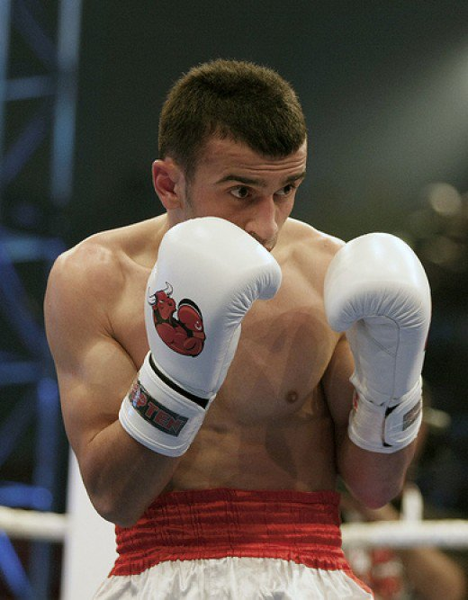 A boxer with his hands in the Guard Stance