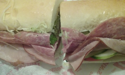 Jimmy John's sandwich with turkey, salami, heaps of fresh and tasty shredded lettuce, tomato slices, cucumber slices,..