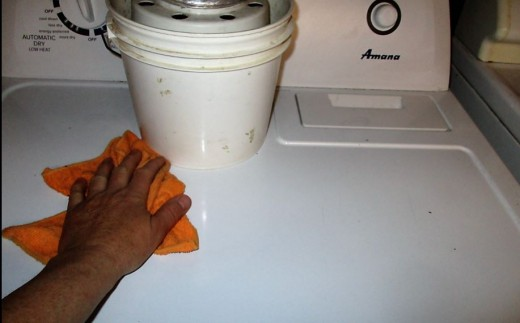 The Wipe Off Top of Dryer - Wipe Excess Dust from Top of Dryer - Using circles and side to side motion