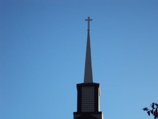 Up above the steeples the sky paints your canvas, and the wind doesn['t even have to blow!