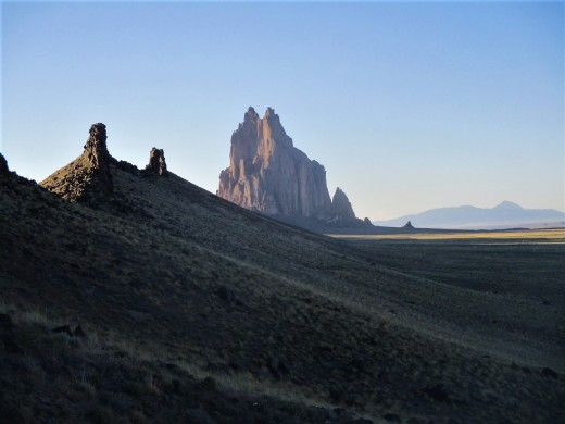 When viewed from the south, late in the day, Shiprock can appear to resemble a ship out on the sea, photo by author