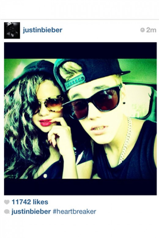 Justin posts a picture of the couple on July 4, but Selena, when approached by the media, denies any rumors of being back together with him and claims to be single. Explains Bieb's caption. #heartbreak.