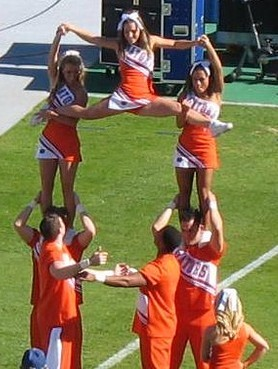 University of Florida Gators  practice a pyramid during a  college game.