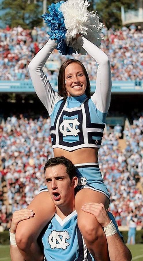 Tarheels cheerleader gets free  ride aka a taxi by male cheerleader.