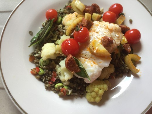 Cod parcels served on a mixture of lentils, wild rice and vegetables