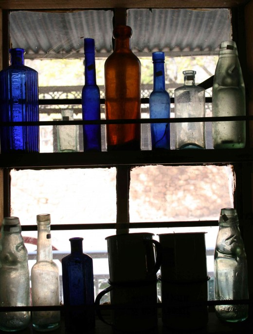 Colourful bottles in a window