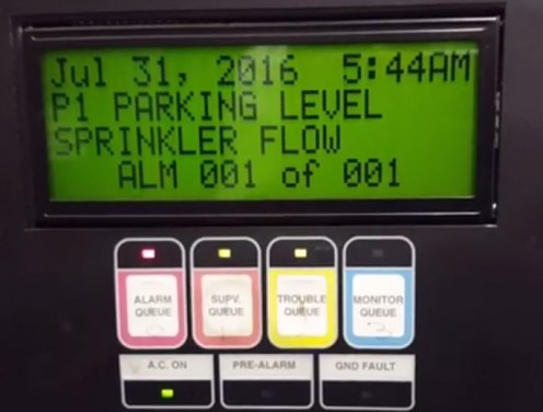 Fire alarm panel in an unusual simultaneous trouble, supervisory, and alarm state caused by a faulty sprinkler flow detector.