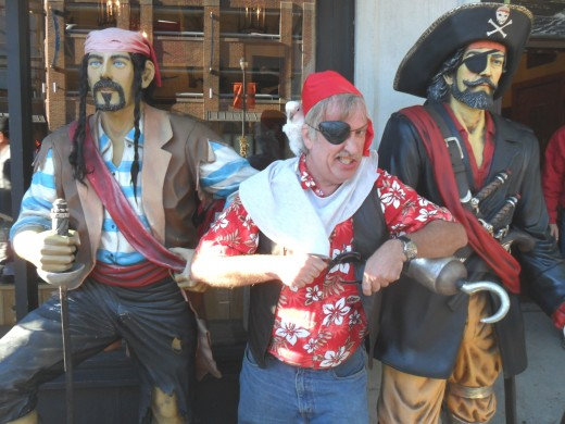 Three scurvy scalawags and their parrot pal.